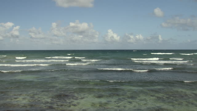 waves break as they approach a beach, yucatan peninsula - coastline stock videos & royalty-free footage