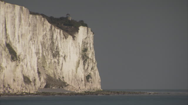 Waves break at the base of the White Cliffs of Dover.