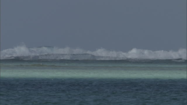 waves break onto reef at edge of tropical lagoon, palmyra atoll, usa - south pacific ocean stock videos & royalty-free footage
