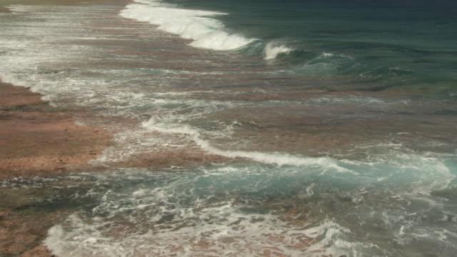 waves break onto reef at edge of tropical lagoon, rangiroa, french polynesia - tropical climate stock videos & royalty-free footage