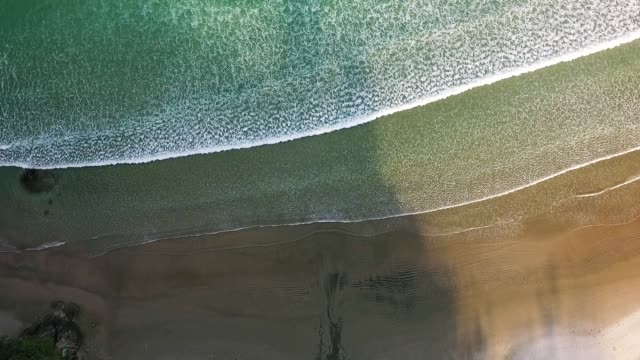 waves breaking at waihi beach. - abundance stock videos & royalty-free footage