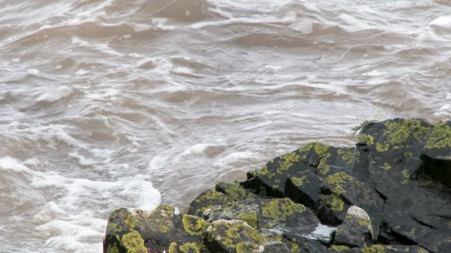 waves breaking on a rocky shore - johnfscott stock videos & royalty-free footage