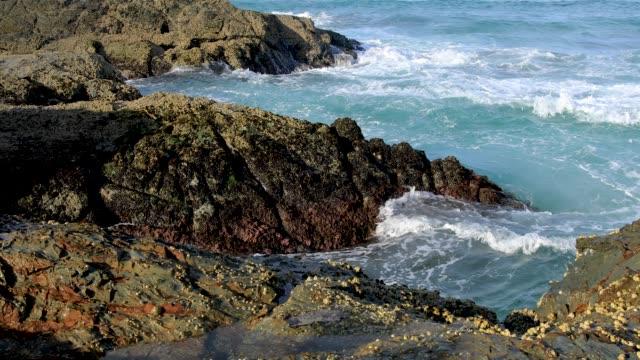 Waves Breaking On Rocky Coastline