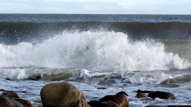 Waves breaking on the shore in Dumfries and Galloway, Scotland