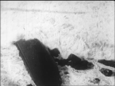 stockvideo's en b-roll-footage met waves breaking over wrecked lifeboat from luistania disaster on coast of ireland / newsreel - scheepswrak
