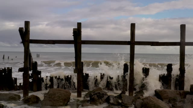 waves crash against destroyed sea defences in the village of happisburgh on november 06, 2019 in great yarmouth, england. the sea defences, which... - eroded stock videos & royalty-free footage