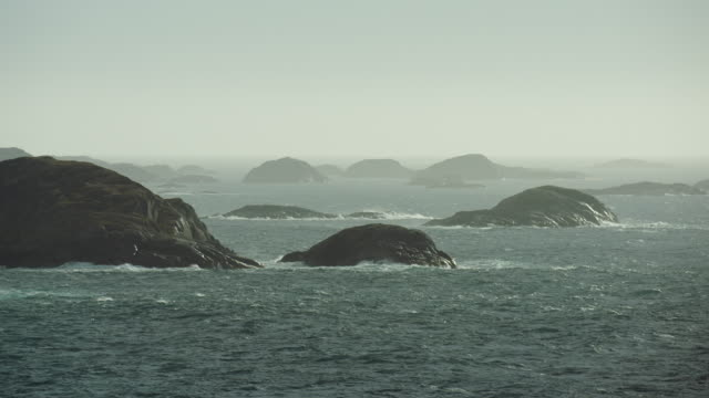 waves crash against small islands - seascape stock videos & royalty-free footage