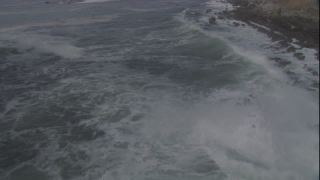 waves crash against the rocky shore of the falkland islands. available in hd - falkland islands stock videos and b-roll footage