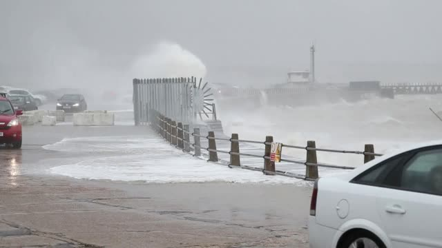 waves crash against the sea wall in newhaven east sussex as the strong winds and rain of storm ciara batter the uk - strength stock videos & royalty-free footage