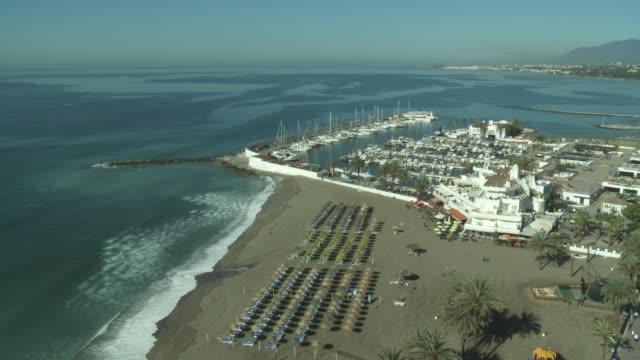 Waves crash along the shoreline of a beach in Marbella.
