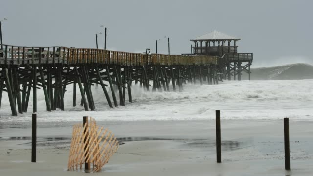 waves crash around the oceana pier as the outer edges of hurricane florence being to affect the coast september 13 2018 in atlantic beach united... - atlantic beach north carolina stock videos & royalty-free footage