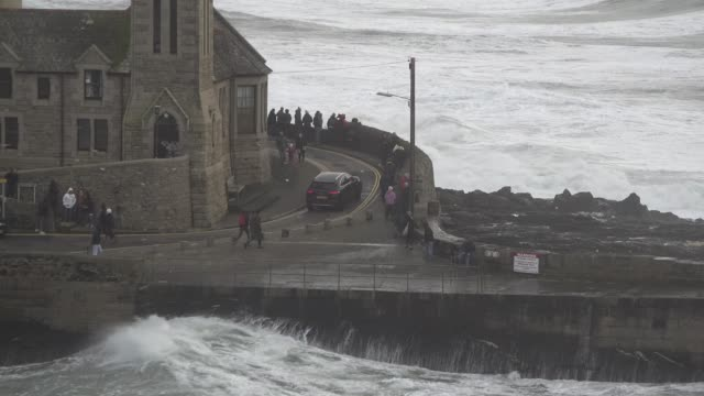 waves crash into the historic harbour taking bystanders by surprise as storm ciara coincides with high tide - incidental people stock videos & royalty-free footage