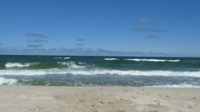 waves crash on a beach. - baltic sea stock videos and b-roll footage
