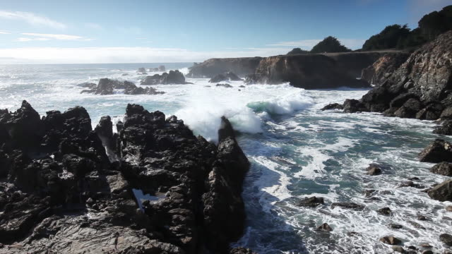 waves crash on rocky shore, wide - wide stock videos and b-roll footage