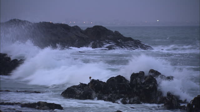 waves crash onto a rocky shore in  south africa - boulder beach western cape province stock videos and b-roll footage
