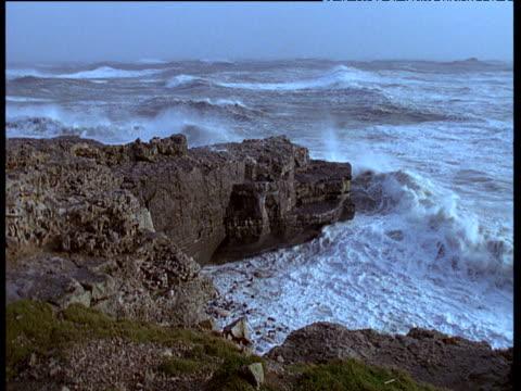 Waves crash onto cliffs in gales, Ireland
