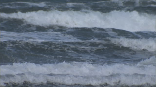 waves crash onto shore. available in hd. - tide stock videos & royalty-free footage