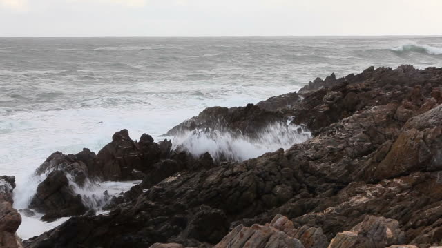 waves crash onto the rocks - tide stock videos & royalty-free footage