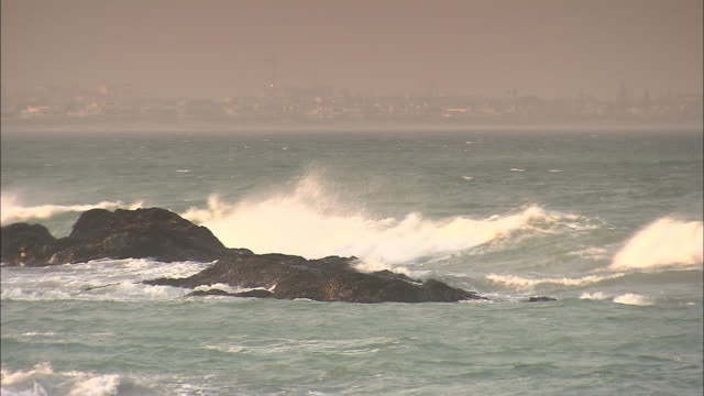 Waves crash over boulders in the ocean off the Cape Peninsula.