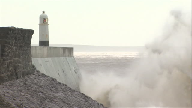 waves crash over porthcawl lighthouse during wind weather during storm hannah - sea stock videos & royalty-free footage