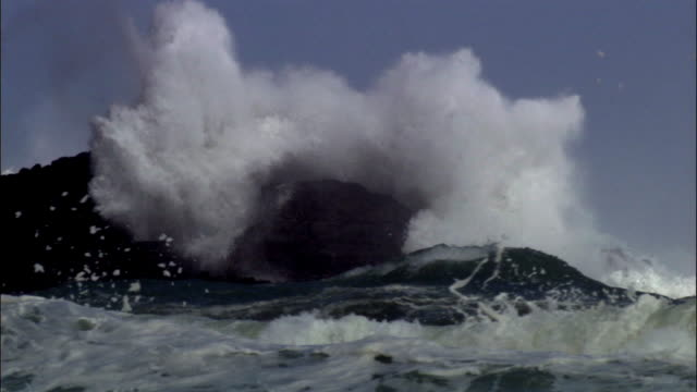 waves crash over rocks during storm, new zealand - rock stock videos & royalty-free footage