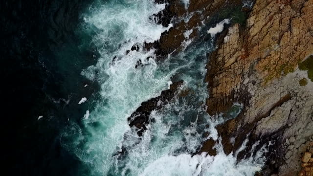 Waves crashing against a rocky coastline