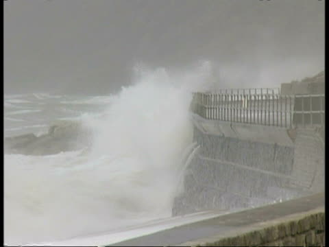 mwa waves crashing against sea wall, spray splashing over wall - roll over stock videos and b-roll footage