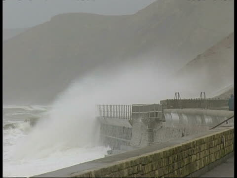 wa waves crashing against sea wall, spray splashing over wall - roll over stock videos and b-roll footage