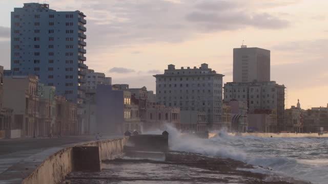 ws waves crashing against seawall / havana, cuba - hitting stock videos & royalty-free footage