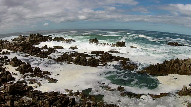 waves crashing against the rocks - tide pool stock videos and b-roll footage