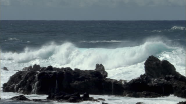 WS PAN Waves crashing against volcanic rocks of Easter Island, Chile