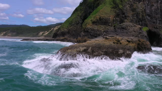 waves crashing into rocks at heceta head from aerial view - heceta head stock videos & royalty-free footage