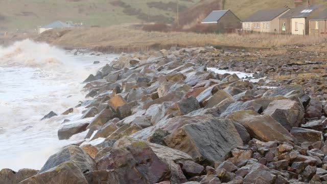 waves crashing off parton near whitehaven during the january 2014 period of storm surge high tides and storm force winds the coastline took a... - atlantic ocean stock videos & royalty-free footage