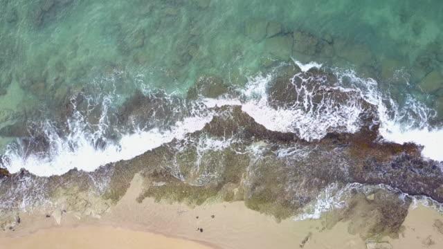 waves crashing on a tropical beach - fatcamera stock videos & royalty-free footage
