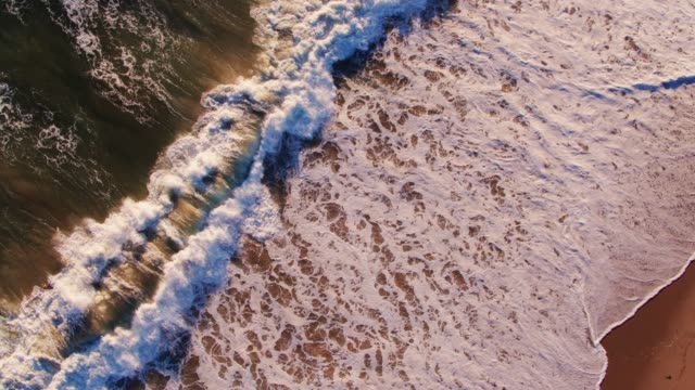 waves crashing on beach from above - malibu stock videos & royalty-free footage