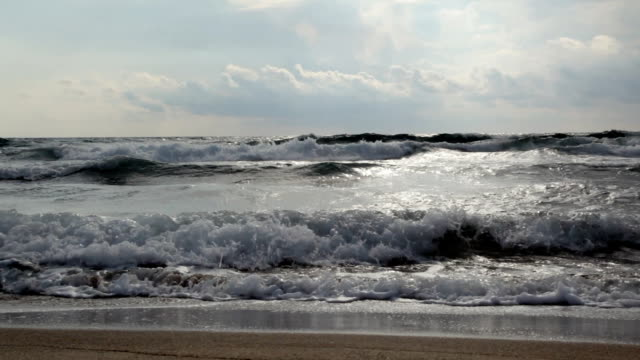 waves crashing on beach - tide stock videos & royalty-free footage