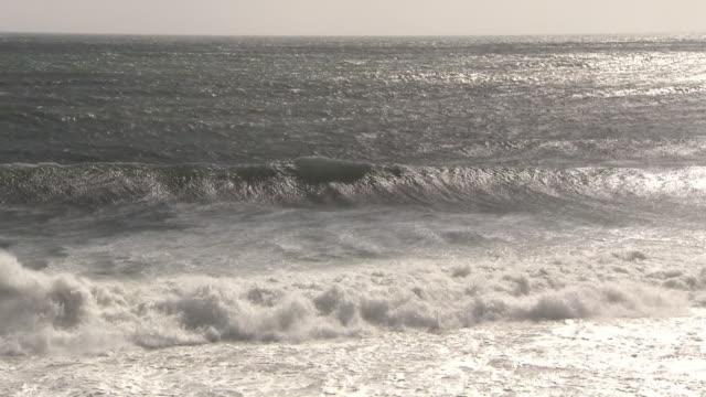 ws waves crashing on coastline - rough stock videos & royalty-free footage