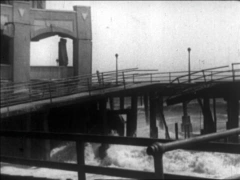 waves crashing on damaged hotel on beach / long beach, california / newsreel - 1926 stock videos & royalty-free footage