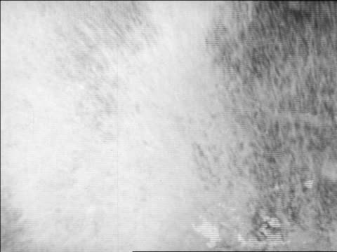 waves crashing on debris from damaged hotel / long beach, california / newsreel - 1926年点の映像素材/bロール