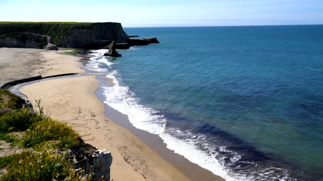 Waves crashing on Empty Beach Northern California Sandy Shorelines deep blue waters and Sunshine
