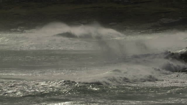 ms slo mo waves crashing on rock / elephant beach, falkland islands, falkland islands - falkland islands stock videos and b-roll footage