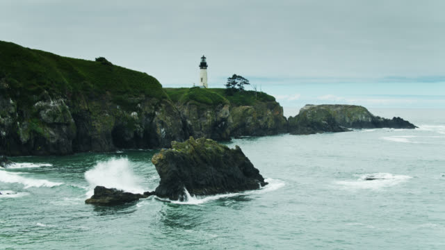 waves crashing on rocks and cliffs at yaquina head lighthouse - oregon coast stock videos & royalty-free footage