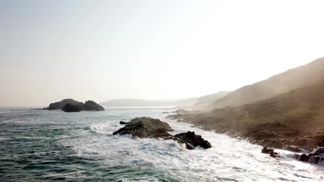 waves crashing on rocky coast in sea against sky - tide stock videos & royalty-free footage