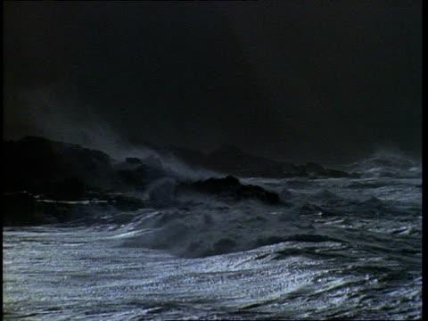 MS Waves crashing on rocky shore