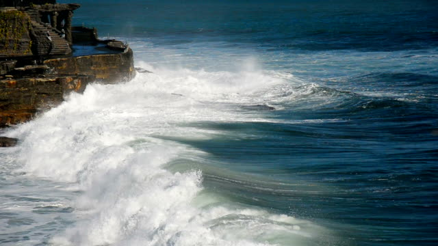 hd: waves crashing on sandy shore at black sand beach bali, indonesia - tsunami stock videos & royalty-free footage