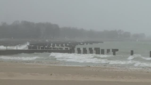 waves crashing on the beach on december 29 2013 in chicago illinois - great lakes stock videos & royalty-free footage