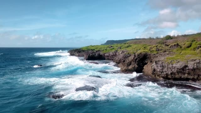 waves crashing on the coast of tamuning guam - guam stock videos and b-roll footage
