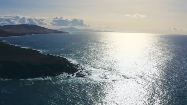 waves crashing on the shore. aerial view - sunny stock videos & royalty-free footage