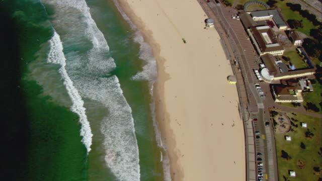 WS AERIAL Waves crashing onto Bondi Beach, Sydney, New South Wales, Australia