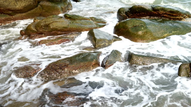waves crashing over coast